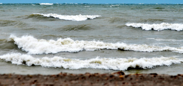 WARREN DILLAWAY / Star Beacon<br /> WAVES POUND the beach at Conneaut Township Park on Monday afternoon.