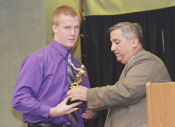WARREN DILLAWAY / Star Beacon<br /> JEFF CASSELLA, Mentor athletic director and Robert L. Wiese Memorial Scholarship Award Committee spokesman,  presents the Robert L. Wiese Memorial Scholarship Award to Justin Butler of Jefferson. on Monday evening at Our Lady of Peace Community Center in Ashtabula during the Ashtabula County Touchdown Club Awards Dinner.