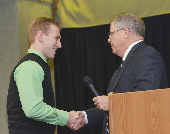 WARREN DILLAWAY / Star Beacon<br /> MARK ANDREWS presents the East Ashtabula Educational Assistance Corporation Scholarship Award to Lakeside High School senior Tyler Loftus on Monday evening at Our Lady of Peace Community Center in Ashtabula during the Ashtabula County Touchdown Club Awards Dinner.