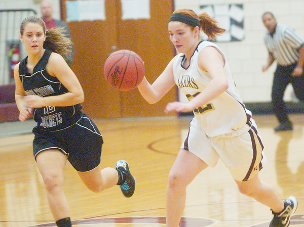 WARREN DILLAWAY / Star Beacon<br /> HEATHER BRANT of Pymatuning Valley dribbles up court onMonday evening with Maplewood's Morgan Hansel in close pursuit in Andover Township.