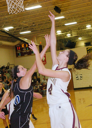 WARREN DILLAWAWY / Star Beacon<br /> ABBY HAMILTON (4) of Pymatuning Valley follows through on a shot as Maplewood's Victoria Karlovic defends on Monday night in Andover Township.