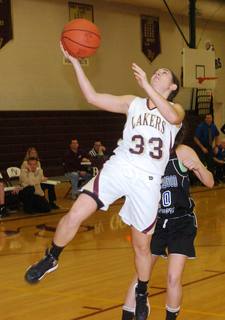 WARREN DDILLAWAY / Star Beacon<br /> MICHAELIA SKLERES of Pymatuning Valley drives for a layup on Monday night during a home game with Maplewood.