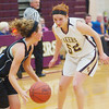 WARREN DILLAWAY / Star Beacon<br /> HEATHER BRANT of Pymatuning Valley defends Maplewood's Miranda Sloan on Monday night in Andover Township.