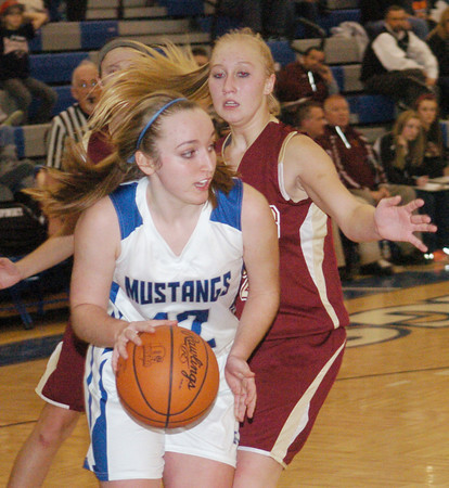 WARREN DILLAWAY / Star Beacon<br /> JESSIC VORMELKER (12) of Grand Valley dribbles the ball by Rebecca Dillon of Pymatuning Valley on Thursday night in Orwell.
