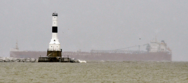 WARREN DILLAWAY / Star Beacon<br /> A LAKE Erie freighter hangs outside the Conneaut Breakwall on Thursday afternoon.