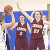 WARREN DILLAWAY / Sar Beacon<br /> GEENA GABIREL (21) and Kelsea Brown (3) of Pymatuning Valley defend Jessica Vormelker (12) of Grand Valley on Thursday evening in Orwell.