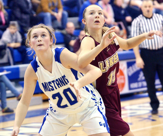 WARREN DILLAWAY / Star Beacon<br /> KATIE FUTTY (20) of Grand Valley and Taylor LIpinsky of Pymatuning VAlley (11) battle for position on Thursday evening in Orwell.