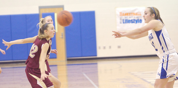WARREN DILLAWAY / Star Beacon<br /> JESSICA VORMELKER (right) of Grand Valley passes the ball to a teammate as Rebecca Dillon of Pymatuning Valley (12) defends on Thursday evening in Orwell.