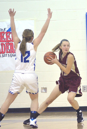 WARREN DILLAWAY / Star Beacon<br /> REBECCA DILLON (with ball) of Pymatuning Valley prepares to pass as Jessica Vormelker (left) of Grand Valley defends on Thursday evening in Orwell.