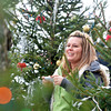 WARREN DILLAWAY / Star Beacon<br /> GRACE PERKINS, of the direct care staff at Creative Learning Workshop in Geneva, takes pictures of clients during a visit to a tree farm at Shannon's Mini Market in Austinburg Township on Friday.