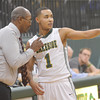 WARREN DILLAWAY / Star Beacon<br /> JIM HOOD, Lakeside basketball coach, instructs Jaedon Jones on Friday evening during a home game with Madison.
