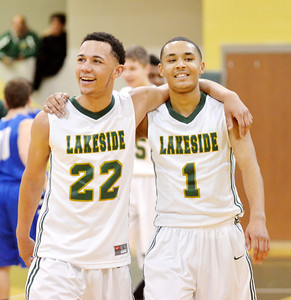 WARREN DILLAWAY / Star Beacon TRISTAN BRADLEY (22) and teammate Jaedon Jones (1) celebrate after defeating Madison on Friday night at Lakeside.