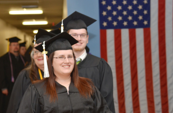 WARREN DILLAWAY / Star Beacon<br /> KENT STATE University-Ashtabula Campus graduates wait to enter the school's gymnasium for commencement exercises on Friday evenning in Ashtabula.