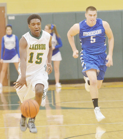 WARREN DILLAWAY / Star Beacon<br /> LORENZ SISTRUNK of Lakeside leads a fast break with Jack Holl of Madison in hot pursuit on Friday  evening at Lakeside.