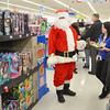 WARREN DILLAWAY / Star Beacon<br /> SANTA CLAUS visited with children involved in the Shop with a Cop program on Saturday at the Super Kmart in Ashtabula Township.