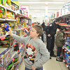 WARREN DILLAWAY / Star Beacon<br /> BRANDON HUDSON, 9, of Conneaut shops during the Conneaut Shop with a Cop program at the Big Kmart store Saturday morning.
