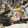 WARREN DILLAWAY / Star Beacon<br /> DECKLAN PERRY picks a present with the help of Ashtabula County Sheriff's Department Deputy Jason Francis on Saturday moring at the Super Kmart in Ashtabula Township during the Shop with a Cop program.