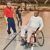 WARREN DILLAWAY / Star Beacon<br /> BILL SEARLES (right) takes a break from drills at a wheelchair basketball clinic directed by Jim Glatch (left), head mens and womens wheelchair basketball coach at Edinboro University, on Saturday at Spire Institute in Harpersfield Township.
