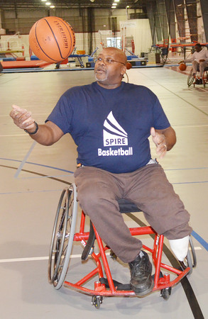 WARREN DILLAWAY / Star Beacon<br /> P.L. LEEK of Akron works on his ball handling skills during  a wheelchair basketball clinic directed at Spire Institute in Harpersfield Township at Spire Institute in Harpersfield Township.