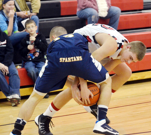 WARREN DILLAWAY / Star Beacon<br /> SAM HITCHCOCK (white uniform) battles for the ball with Mike Teed of Conneaut on Tuesday evening in Jefferson.