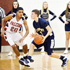 WARREN DILLAWAY / Star Beacon<br /> JUSTIN MYERS (with ball) of Conneaut prepares to pass as Joe Jackson of Jefferson defends on Tuesday evening at Jefferson.
