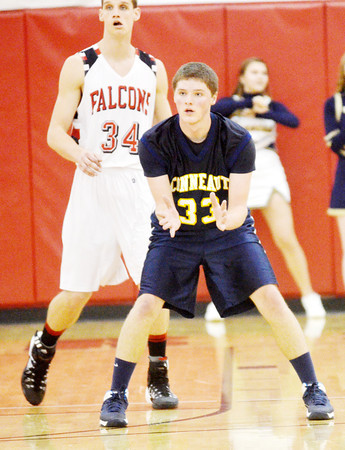 WARREN DILLAWAY / Star Beacon<br /> RYAN OATMAN of Conneaut asks for the ball Tuesday evening as David Chase of Jefferson defends at Jefferson.