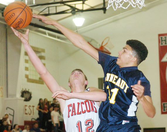 WARREN DILLAWAY / Star Beacon<br /> JAKE SPEES (11) of Conneaut attempts to block a shot by  Sam Hitchcock (12) of Jefferson on Tuesday night in Jefferson.