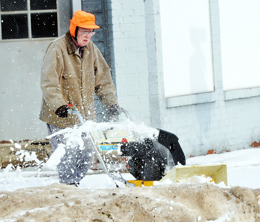 WARREN DILLAWAY / Star Beacon<br /> L.J. RICHMOND clears snow from sidewalks at the intersectiion of West Third Street and Lake Avenue on Thursday afternoon in Ashtabula.