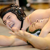 WARREN DILLAWAY / Star Beacon<br /> TYREE MEEKS (right) of Lakeside tries to keep his shoulders off the mat during a 195 pound bout with Jacob Huang of Geneva.
