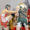 WARREN DILLAWAY / Star Beacon<br /> TRAVIS BLAKE (left) of Geneva tries to escape the grasp of Michael Coup of Lakeside on Thursday evening  during a 170 pound bout at Geneva.