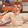WARREN DILLAWAY / Star Beacon<br /> KODY BROWN (foreground) of Geneva tries to pin Ja'Sean Hatfield of Lakeside as referee Todd Victor watches closely on Thursday night during a 160 pound bout at Geneva.