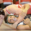 WARREN DILLAWAY / Star Beacon<br /> TYREE MEEKS of Lakeside (foreground) reacts while wrestling Jacob Huang of Geneva during a 182 pound bout on Thursday evening at Geneva.