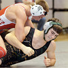 WARREN DILLAWAY / Star Beacon<br /> CYLE MCAFEE (bottom) of Lakeside tries to escape the grasp of Tyler Cross of Geneva  on Thursday night at Geneva during a 145 pound bout.