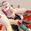 WARREN DILLAWAY / Star Beacon<br /> JOSEPH KANGAS of Lakeside (facing) wrestles Anthony Barszczewski of Geneva during a  152 pound bout on Thursday at Geneva.