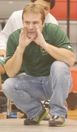 WARREN DILLAWAY / Star Beacon<br /> JOE BRADY, Lakeside wrestling coach, encourages his team Thursday during a match at Geneva.