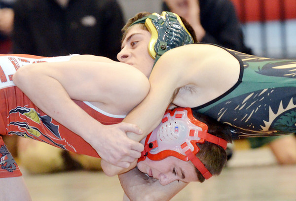 WARREN DILLAWAY / Star Beacon<br /> KYLER MCENDREE (top) of Lakeside wrestles Connor Requa of Geneva during a 113 pound bout at Geneva on Thursday night.
