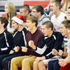 FRANK FIORITTO (arm in air) and sophomore classmates Zach Collins (middle and Sage Cantini (Santa hat) cheer on classmates during the traditional event.