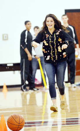 KYCEE FUSCO, a sophomore, races afterwitha golf ball on a spoon during Reindeer Games.