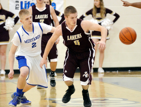 WARREN DILLAWAY / Star Beacon<br /> AUSTYYN SPOON (2) of Grand Valley and Nick Blascak of Pymatuning Valley react to a loose ball on Friday night in Orwell.