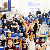 WARREN DILLAWAY / Star Beacon<br /> THE BALL goes off theee backboard as Chase Thurber (25 facing) of Pymatunning Valley and Gabe Kovats (3) of Geneva leap  in the air on Friday evening in Orwell.
