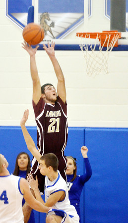 WARREN DILLAWAY / Star Beacon<br /> QUINTIN RATLIFF of Pymatuning Valley leaps above Grand Valley defenders to shoot  on Friday evening in Orwell.