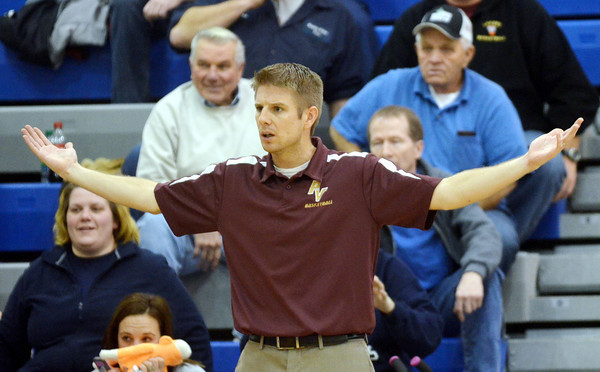 WARREN DILLAWAY / Star Beacon<br /> RYAN SHONTZ, Pymatuning Valley boys basketball coach, watches the action on Friday evening at Grand Valley.