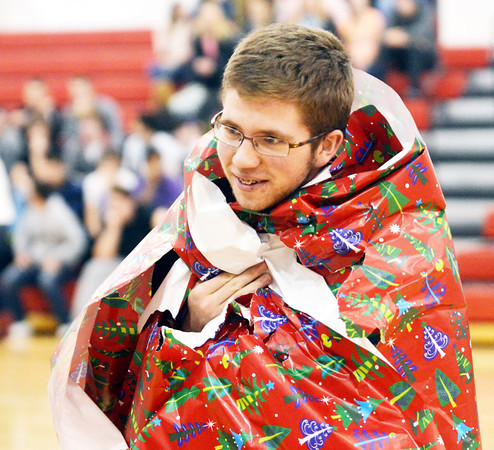 """JULIAN LAVALLE, a freshman at Jefferson High School, displays his """"gift costume"""" for the judges during the Reindeer Games."""