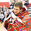 "JULIAN LAVALLE, a freshman at Jefferson High School, displays his ""gift costume"" for the judges during the Reindeer Games."