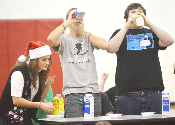 EGG NOG chugging was just one of the many games played at Reindeer Games at Jefferson High School. Colleen O'Connor, a senior, Steve Zindash (center) and Jonn Starkey participate in the challenge.