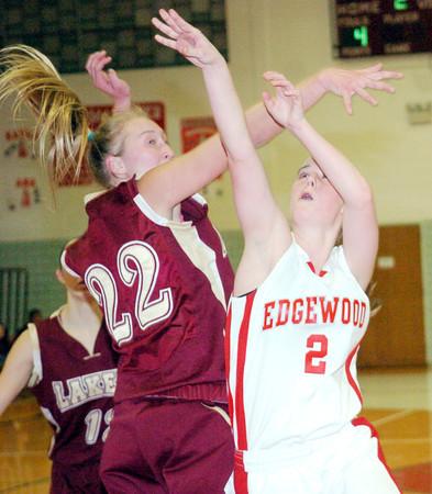 WARREN DILLAWAY / Star Beacon<br /> CARRIE PASCARELLA (2) of Edgewood follows through on a shot as Megan Stech attempts a block on Monday evening at Edgewood.