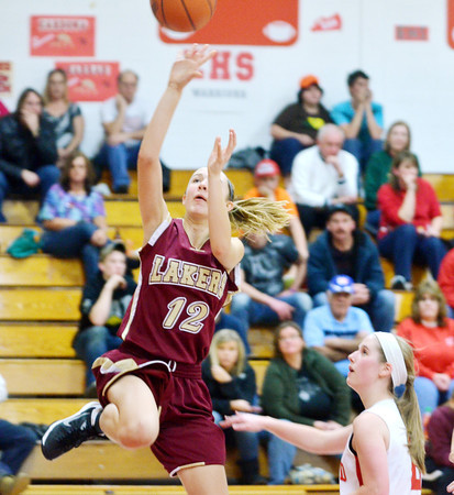 WARREN DILLAWAY / Star Beacon<br /> REBECCA DILLON of Pymatuning Valley drives to the basket with Carrie Pascarella of Edgewood following the play.