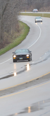 WARREN DILLAWAY / Star Beacon<br /> RAIN ROADS reflected car lights along Route 7 in Conneaut on Monday morning.