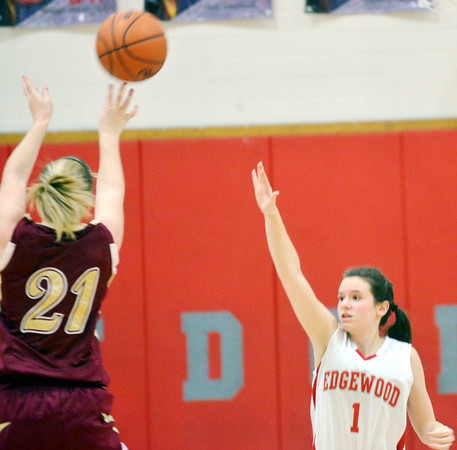 WARREN DILLAWAY / Star Bacon<br /> GEENA GABRIEL of Pymatuning Valley (21) shoots a jumpe over Haley Holden of Edgewood on Monday night in Edgewood.