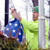 WARREN DILLAWAY / Star Beacon<br /> WILLIAM HITCHCOCK, of the Jefferson Village Street Department, prepares to raise a new flag at a pole in the village square on Monday afternoon.